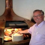 Alain Bailleux, one of the Brewers at Brasserie Bailleux, cooking out of a copper brew kettle